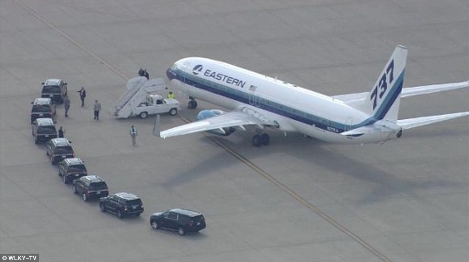 A private plane carrying the boxing great's body arrived in Louisville from Arizona, where he died, at around 4.30pm on Sunday