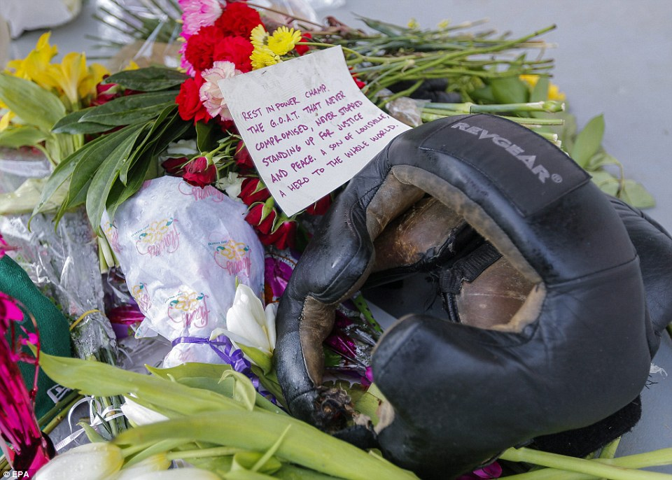 A mourner wrote a a heartfelt note about Ali, calling him a 'hero to the whole world' in a tribute left outside his childhood home