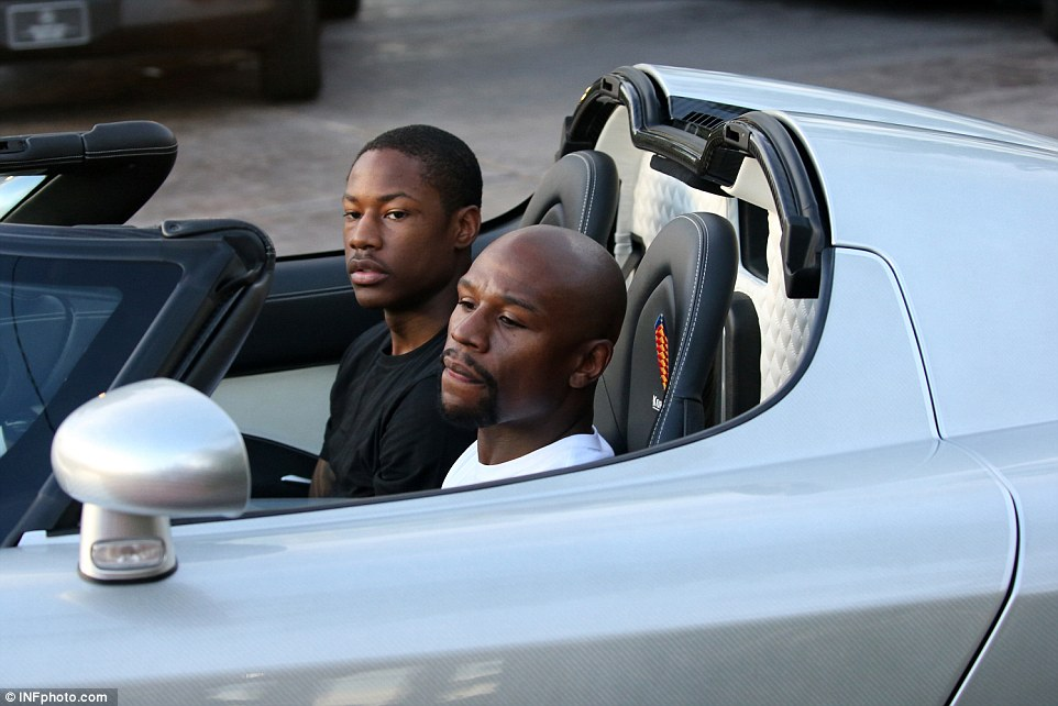 Floyd Mayweather Jr. (right, outside the Fontainebleau Miami Beach hotel) is seen for the first time since the death of Muhammad Ali