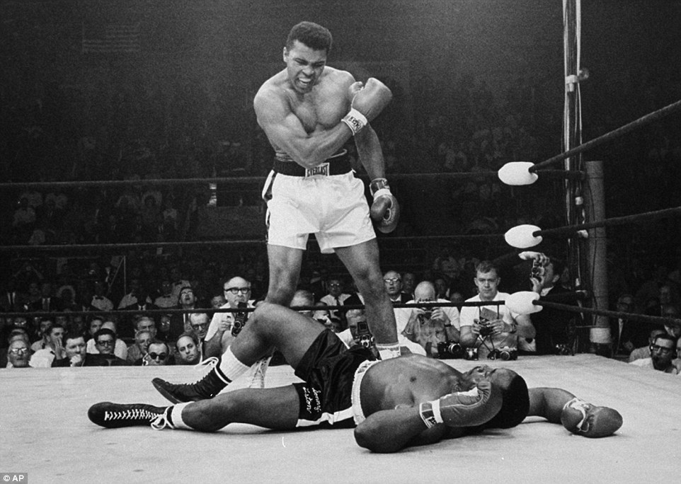 The Greatest: Muhammad Ali stands over fallen challenger Sonny Liston after he dropped him with a short hard right to the jaw in Lewiston, Maine in 1965