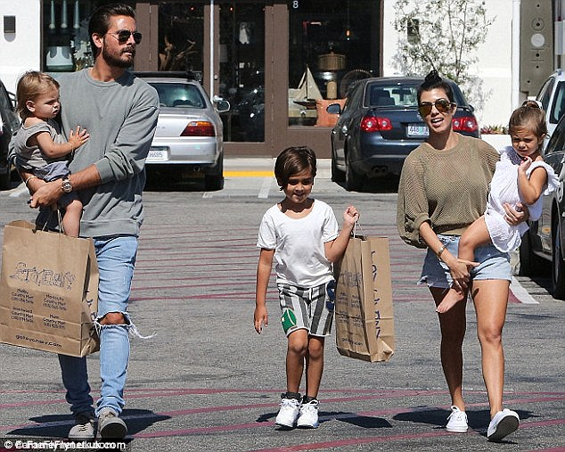 Happy families? Earlier on Sunday, Kourtney headed out for a meal in Los Angeles with ex beau of nine years Scott and their three children, Mason, six, Penelope, three, and one-year-old son Reign