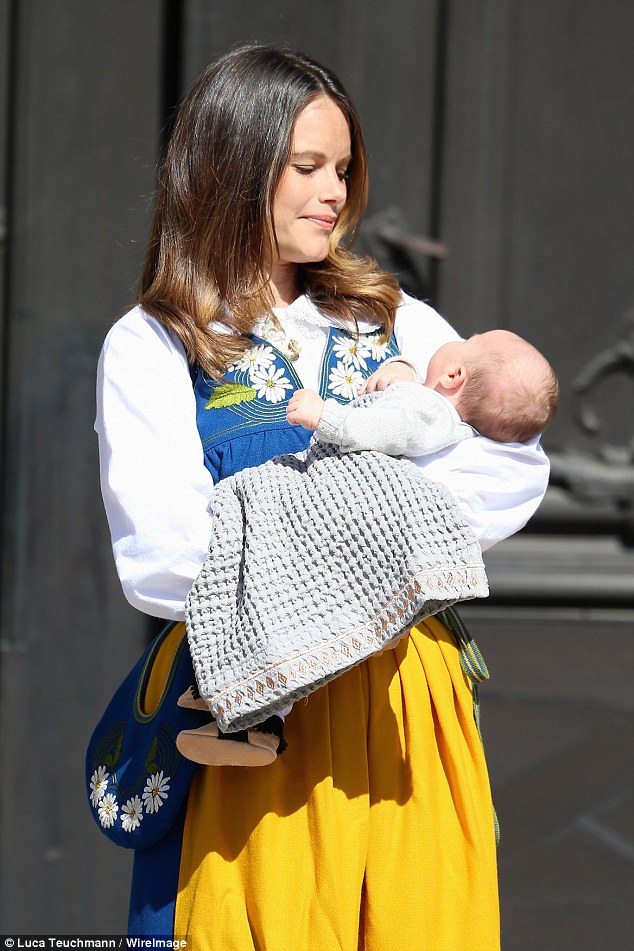 Doting new mother Princess Sofia checks that her little one is comfortable