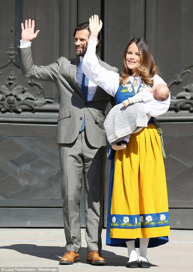 Princess Sofia wore the traditonal dress of a brightly coloured folk outfit: a blue dress over a white collared shirt, with a mustard-coloured apron