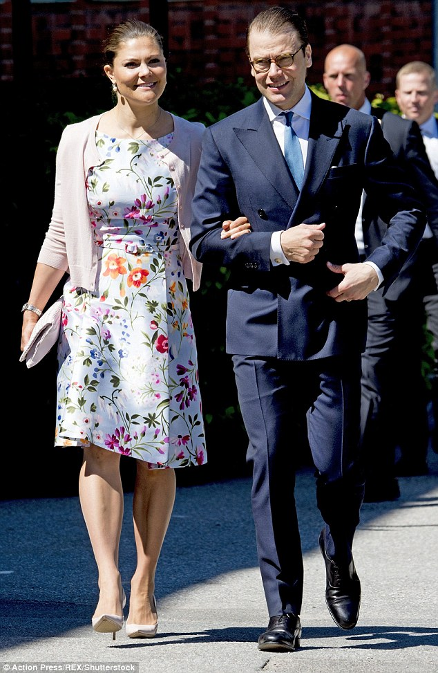 Prince Daniel looked smart in a dark blue suit as the couple strolled arm in arm