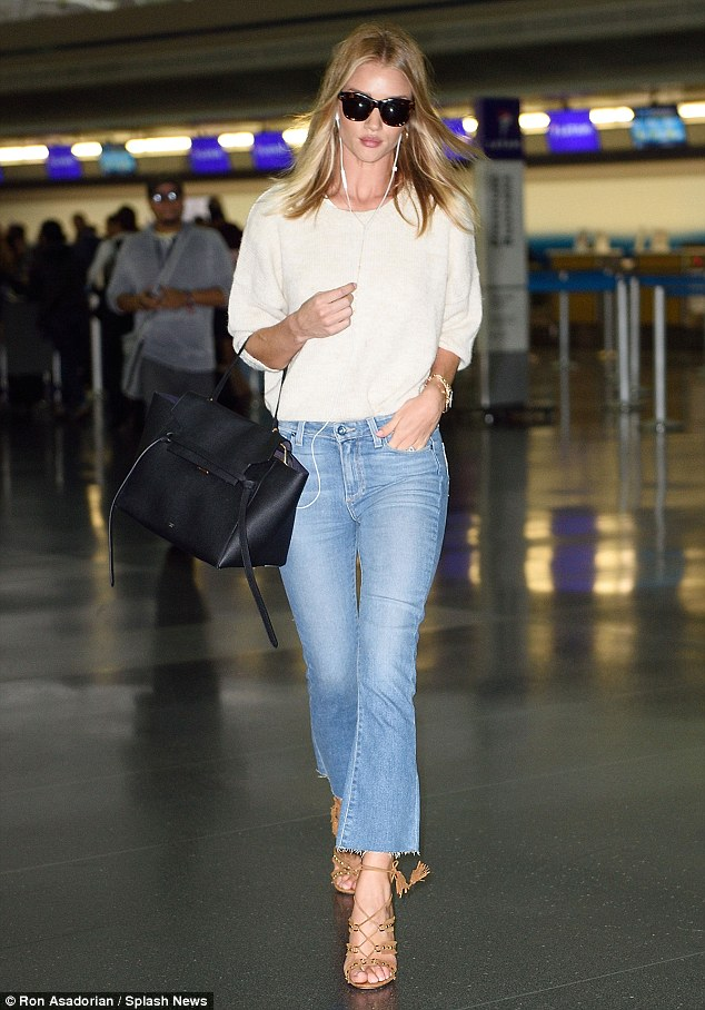 Touch down:Rosie Huntington-Whiteley took a step back in time as she arrived in New York on Sunday