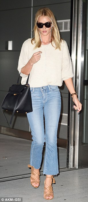 The 29-year-old model rocked a retro look in flared trousers as she touched down at JFK airport