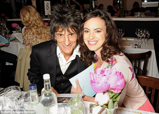 Proud parents: Ronnie Wood and his wife Sally, 38, are celebrating the birth of twins