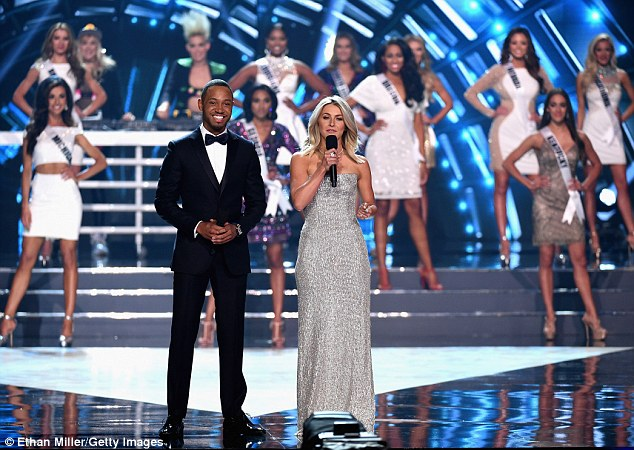 Don't read out the wrong name! Instead, Julianne had Terrence 'J' Jenkins by her side to help her present onstage the T-Mobile Arena