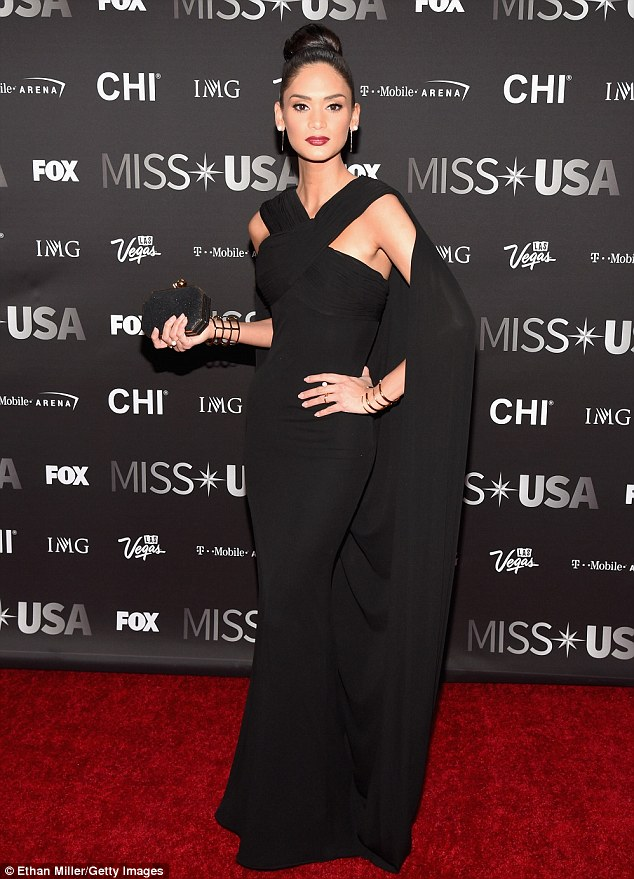 And don't you forget it!The Filipino-German 26-year-old - whom Steve Harvey mistakingly called runner-up last December - looked elegant in a black caped gown and tidy top-bun