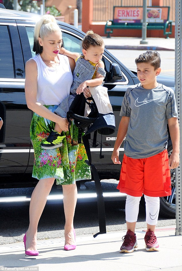 Family affair: The Make Me Like You hit-maker and her sons - Kingston, 10, and Apollo, aged two, also wore bright colors to coordinate with their mum