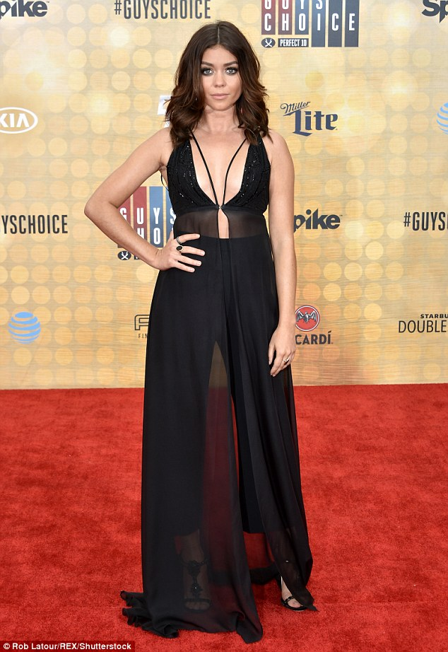 Vamping it up! Sarah Hyland, meanwhile, looked vampy in a plunging black ensemble that showed some skin