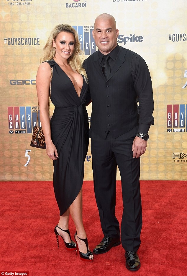Red carpet ready! Tito Ortiz struck a pose beside Amber Miller