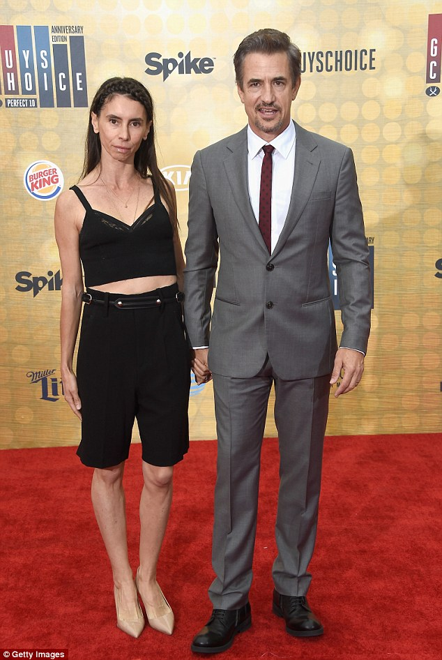 Love is in the air! Dermot Mulroney smartened up in a dark grey suit as he held hands with his wife, Tharita Cesaroni
