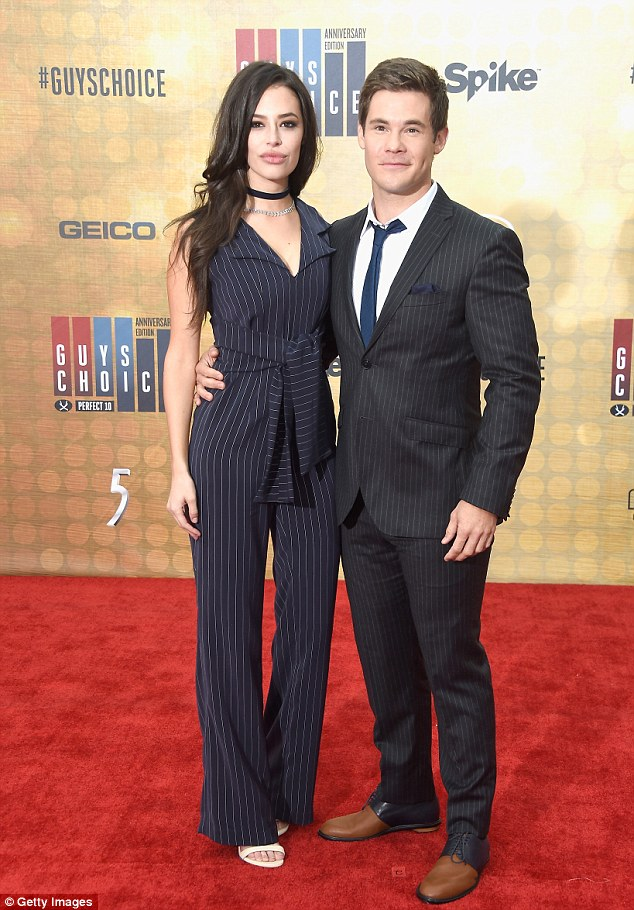 Earning their fashion stripes! Chloe Bridges and Adam DeVine matched in their pinstripe outfits