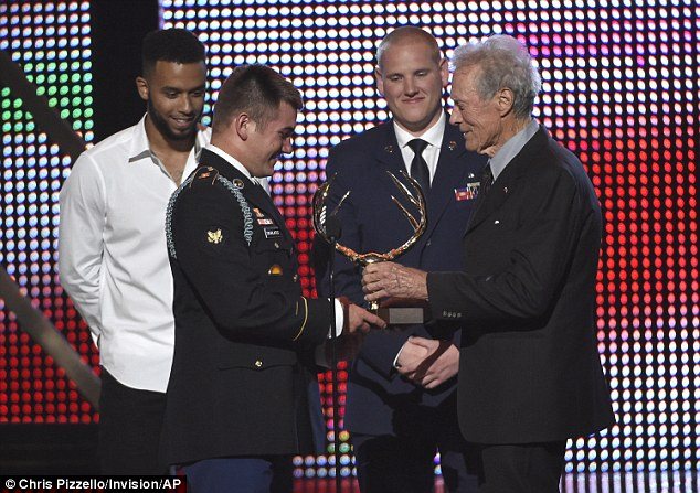 Well-deserved: Clint Eastwood presented the hero award to Anthony Sadler, (L-R) Alek Skarlatos, and Spencer Stone as he took to the stage