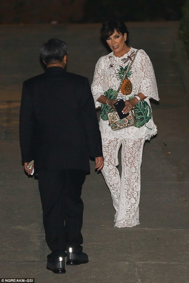Summer stylin': Kris Jenner sported a white lace jumpsuit with a tropical design as they exited her good friend's birthday