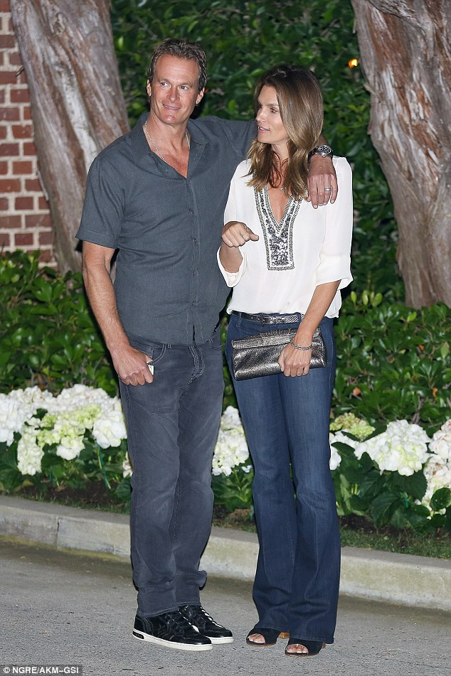 Party pals: Gerber looked dashing and casual cool in his jeans and grey shirt