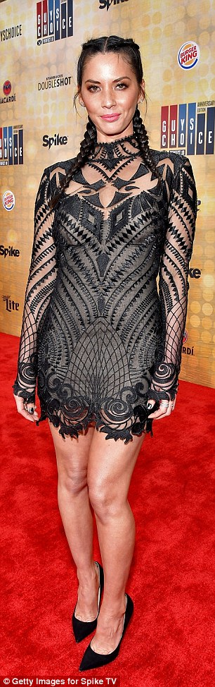 Her look: The X-Men: Apocalypse actress wore a form-fitting, deco-design frock with a high-collar