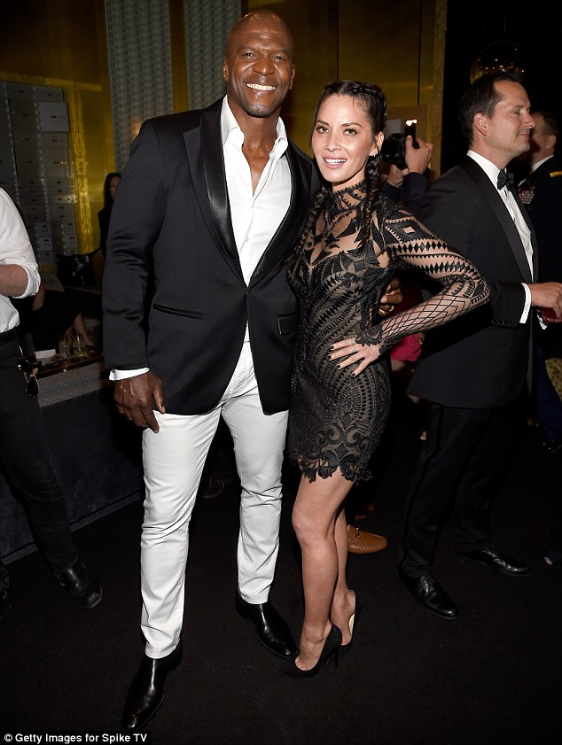 Good friends: Olivia shared a side hug with pal Terry Crews, 47