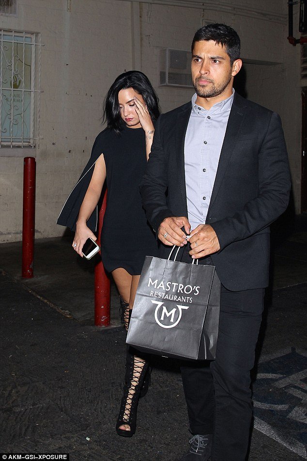 Somber: Demi and Wilmer looked downcast as they left LA club Three Clubs on May 24