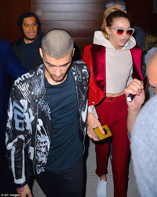Staying close: Gigi starred in the music video for Pillowtalk, where the duo are seen kissing and embracing each other; pictured on March 25 in New York City