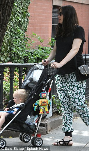 Hello petal!Liv looked radiant and in good spirits as she hit her stride, putting her bump on show in a black short-sleeve top while adding a summery pop with her comfortable floral print trousers