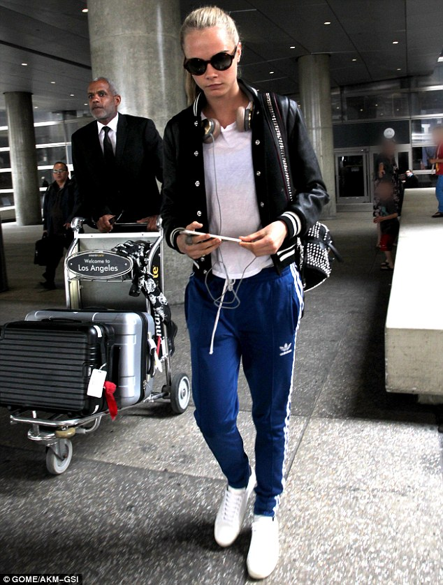 Stylish: Cara Delevingne was spotted at LAX airport on Saturday dressed in a casual ensemble
