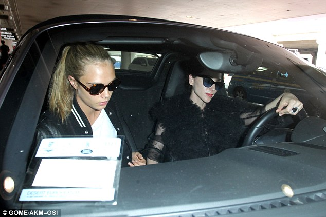 Heading home: Cara's girlfriend, St. Vincent waited curbside for her love