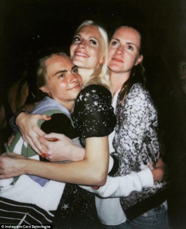 Family first: She also shared a picture of herself with her two older sisters as they shared a hug, captioning it: 'I love my sisters so very much'