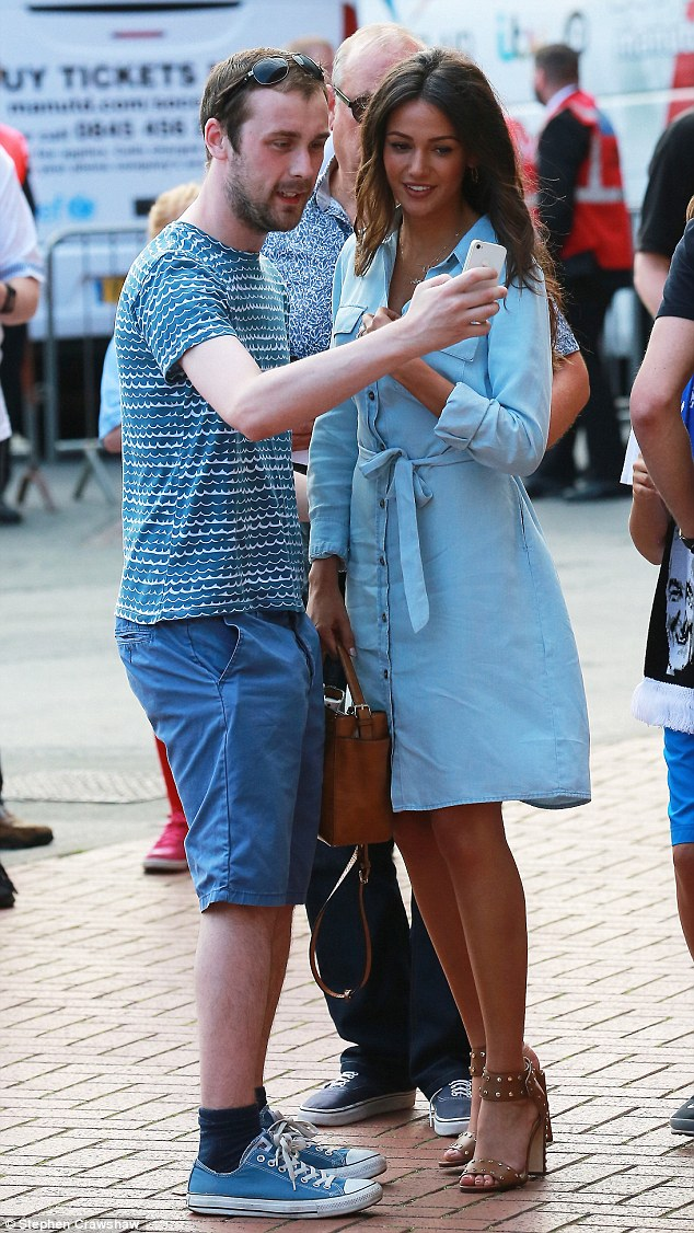 A treat for the fans: Michelle made one attendee's day by posing for a selfie with him