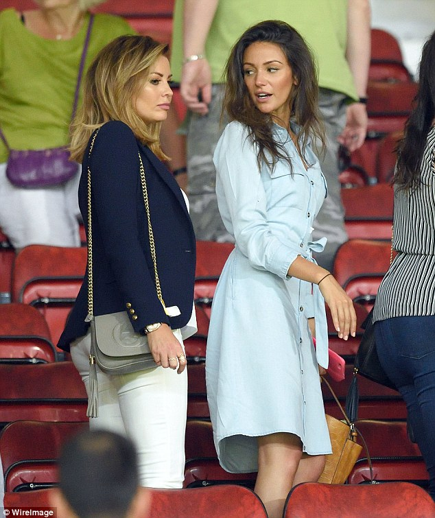 Perhaps we could find you a footballer boyfriend? Michelle chats to her sister-in-law Jessica as they leave the stadium after the match