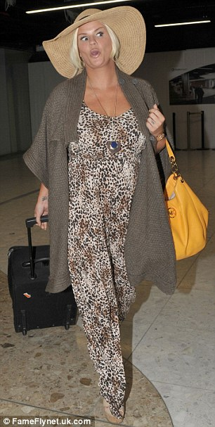In high spirits: Laughing and pulling faces as she strolled through the airport, the Warrington-born singer even flashed a cheeky peace sign
