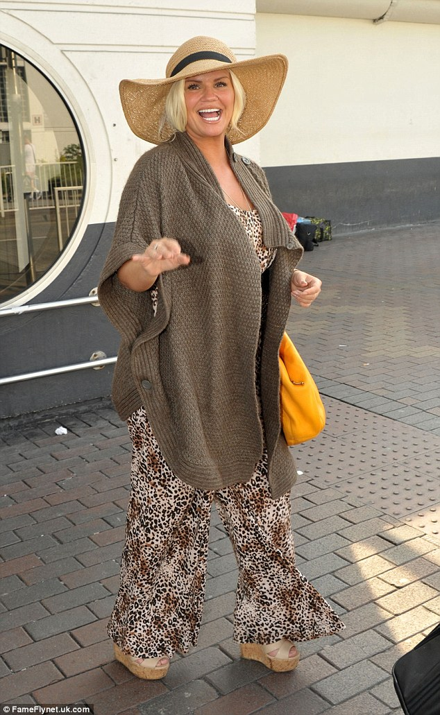 Ready for the sun! She finished her sunny look off with a floppy straw hat, whilst she accessorised with a a few pieces of bling-tastic jewellery and a bright orange handbag
