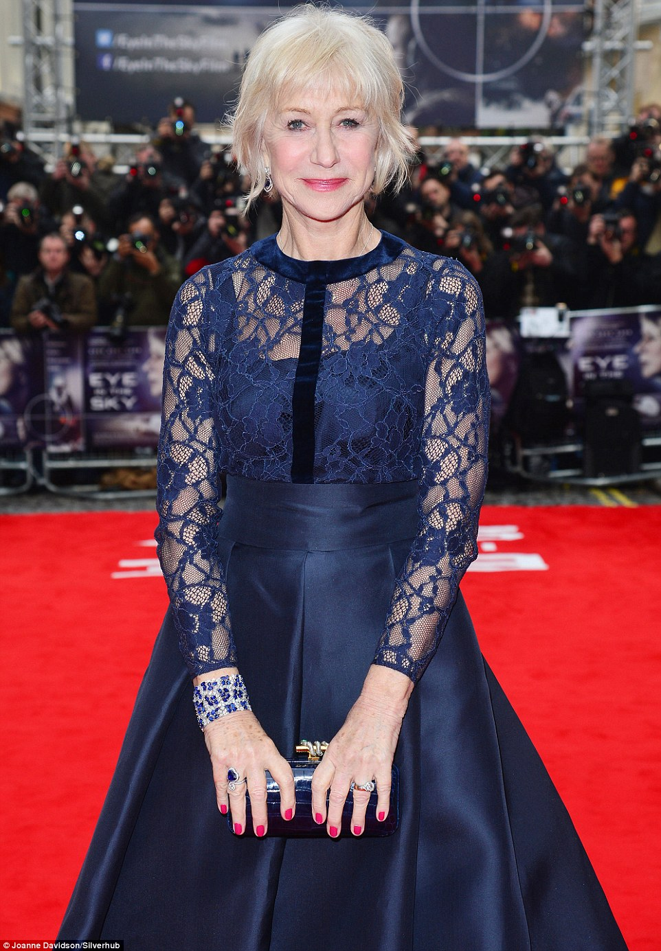Arriving in style! Hitting the red carpet at the Curzon cinema in Mayfair flanked by a pair of soldiers, Dame Helen Mirren cut a striking figure in a lace dress as she arrived to promote her late co-star and friend Alan Rickman's last feature film, Eye In The Sky, in London