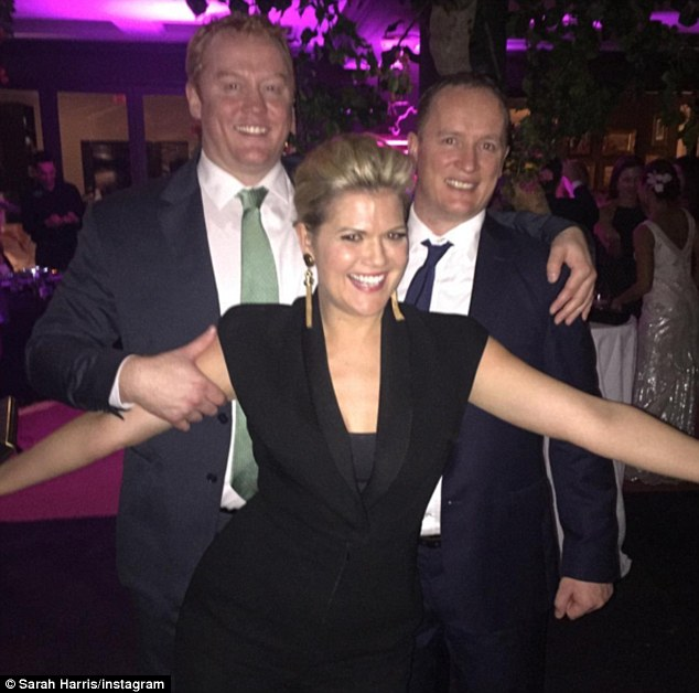 Having fun! Sarah also shared another snap to Instagram of herself posing with her arms out as Tom and a male pal stand behind her