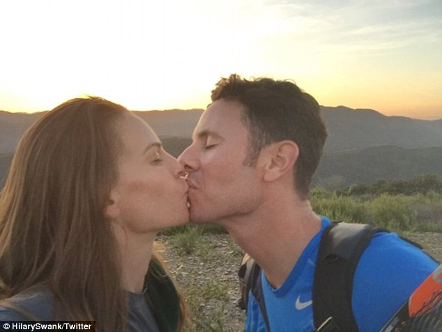 Smitten: She followed up the shot with a picture of the two kissing against the sunset, gushing: 'And then this happened....#sealedwithakiss'
