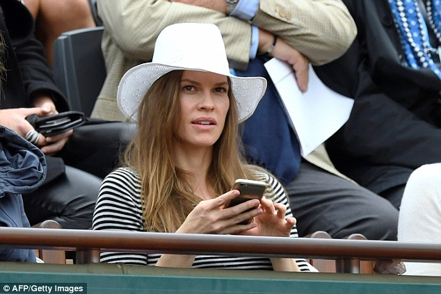 Downtime: Taking a break from filming an upcoming project in Germany to watch the French Open, where U.S. star Serena Williams is taking on Spain's Garbine Muguruza at the Rolan Garros stadium in Paris