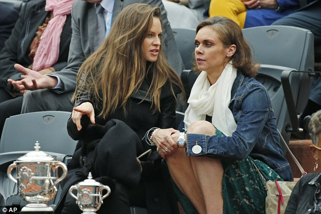 Bonding: The actress was seen chatting to a female friend as she watched the game
