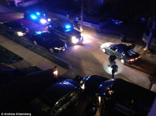 Aftermath: When the gun battle was over, police rushed to where the green sedan was parked and announced there were other devices on the street, sparking a search
