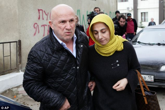 Mother: Zubeidat Tsarnaeva, mother of the two suspected bombers walks with an unidentified man near her home in Makhachkala, Dagestan, southern Russia on Tuesday
