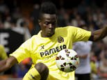 Villarreal's Eric Bailly (L) and Valencia's Francisco Alcacer fight for the ball during their Spanish first division soccer match at the Mestalla stadium in Valencia April 5, 2015. REUTERS/Heino Kalis - RTR4W6EE