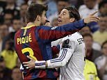 FC Barcelona's Gerard Pique, left, and Real Madrid's Sergio Ramos argue during their semifinal first leg Champions League soccer match against Real Madrid at the Santiago Bernabeu stadium in Madrid, Wednesday, April 27, 2011.      (AP Photo/Paul White)