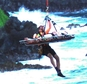 In this May 29, 2016 photo made with a cell phone provided by Vicki Sawyer, rescue workers lift Alexandria Duval, who is also known as Alison Dadow, from the bottom of a cliff on Maui¿s Hana Highway in Hana, Hawaii. The Maui woman who was driving a vehicle that plunged off the cliff is charged with murder in the death of her twin, who was in the passenger's seat. Prosecutors say Alexandria Duval, who is also known as Alison Dadow, intentionally caused the death of her sister, Anastasia Duval, also known as Ann Dadow. The 37-year-old sisters were traveling on Hana Highway when their Ford Explorer crashed into a rock wall last week. Police say the Explorer fell about 200 feet. (Vicki Sawyer via AP) MANDATORY CREDIT