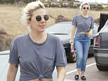 EXCLUSIVE TO INF.\nJune 05, 2016: Lady Gaga keeps it casual on a cloudy Sunday in Malibu, California. The singer sported a vintage gray t-shirt, which was tied up to reveal her navel, and rolled up blue jeans as she picked up supplies at her local grocery store.\nMandatory Credit: Boriso/SAA/INFphoto.com Ref: infusla-277/301