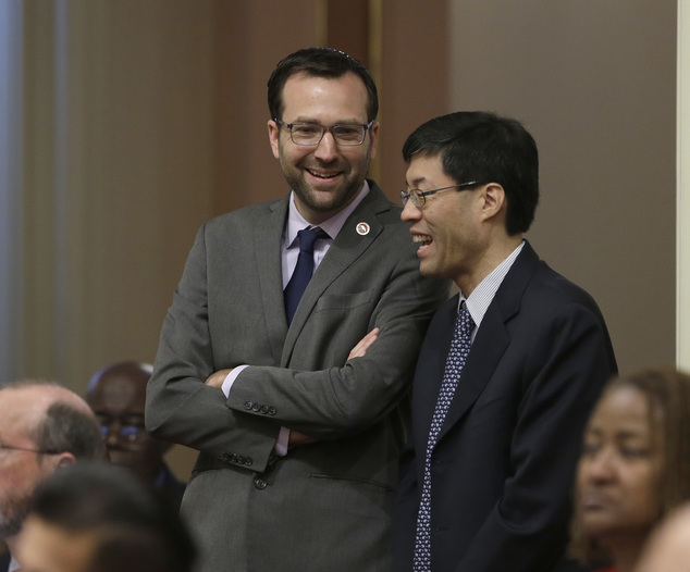 State Sen. Ben Allen, D-Santa Monica, left, smiles as he and Sen. Richard Pan, D-Sacramento, watch as the votes are posted for his emergency legislation that...