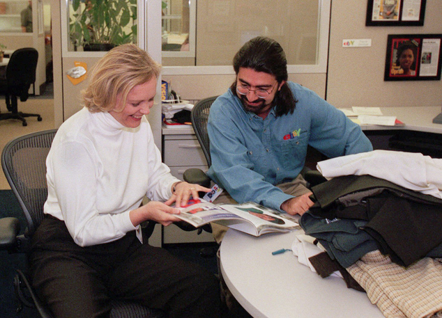File - In this May 21, 1999 file photo, eBay chief executive officer Meg Whitman, left, and Pierre Omidyar, eBay's chairman of the board, leaf through a maga...