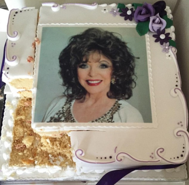 Loved ones at Joan Collins¿s birthday celebrations could not bear to cut into a cake with her face emblazoned on it, so instead they ate around the photo of the 83-year-old star