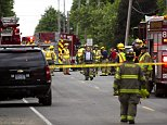Police and rescue workers attend to the scene after multiple bicyclists were struck by a vehicle in a deadly crash Tuesday, June 7, 2016, in Copper Township, Mich. (Chelsea Purgahn/Kalamazoo Gazette-MLive Media Group via AP) LOCAL TELEVISION OUT; LOCAL RADIO OUT; MANDATORY CREDIT