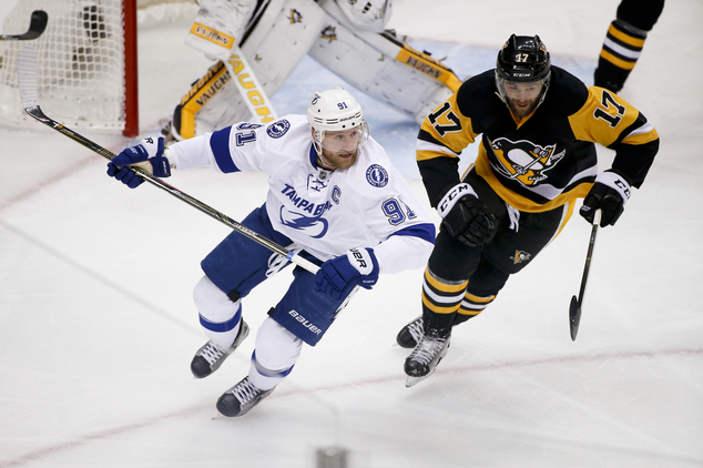Tampa Bay Lightning's Steven Stamkos skates beside Pittsburgh Penguins' Bryan Rust (17) during the first period of Game 7 of the NHL hockey Stanley Cup Easte...