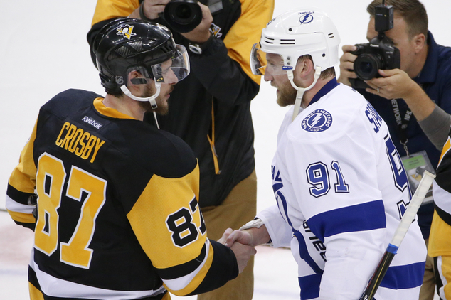 Pittsburgh Penguins' Sidney Crosby (87) shakes hands with Tampa Bay Lightning's Steven Stamkos (91) after Game 7 of the NHL hockey Stanley Cup Eastern Confer...